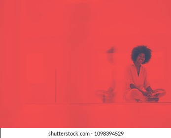beautiful young black women using tablet computer on the floor at home