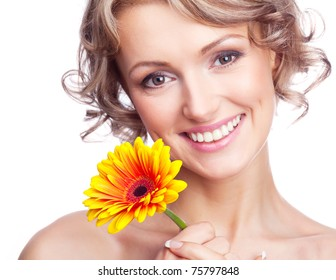 beautiful young blond curly woman with a flower in her hands