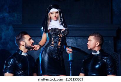 beautiful young blond striptease dancer dressed as a nun,with  two men,dressed as priests,  in the interior