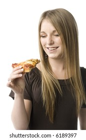 Beautiful young blond woman about to eat a slice of pizza.