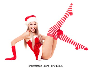 beautiful young blond woman dressed as Santa, isolated against white background