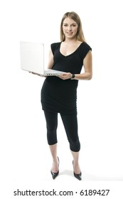Beautiful young blond woman holding a white laptop computer.