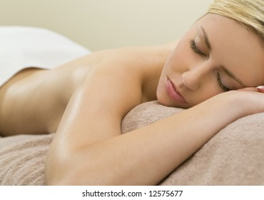 A beautiful young blond woman relaxing in a spa situation
