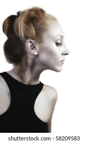 beautiful young blond woman with shiny silver makeup on white background
