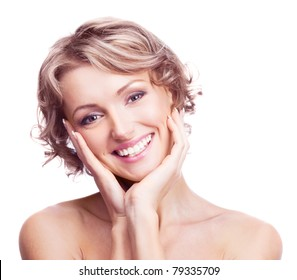 beautiful young blond woman touching her cheeks, isolated against white background