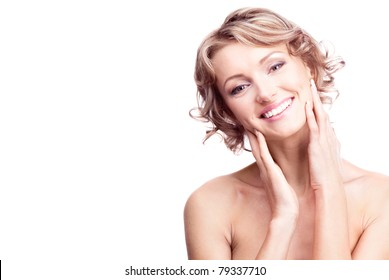 beautiful young blond woman touching her cheeks, isolated against white, a lot of copy space for your text to the left