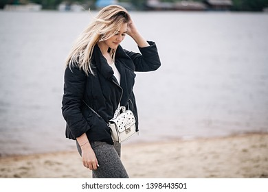 Beautiful young blonde girl on the beach