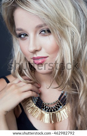 5991e304a Beautiful young blonde girl with trendy accessories in studio. Beauty sexy  fashion model woman portrait