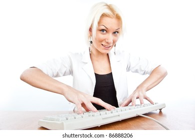 a beautiful young blonde girl works on a keyboard, isolated over white