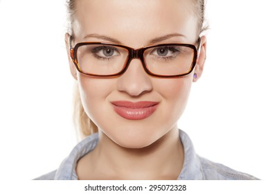 beautiful young blonde with glasses on a white background