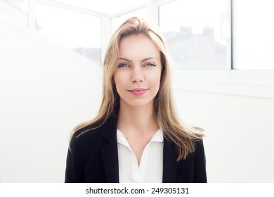 Beautiful young blonde successful business woman in jacket
