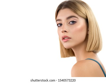Beautiful young blonde woman with perfect skin, short stylish blond bob hairstyle and classical makeup. Isolated on white. Portrait of beauty model girl with natural make up.