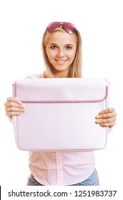 Beautiful young blonde woman smiling and showing pink briefcase, isolated on white background.