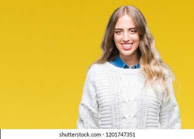 Beautiful young blonde woman wearing winter sweater over isolated background with a happy and cool smile on face. Lucky person.