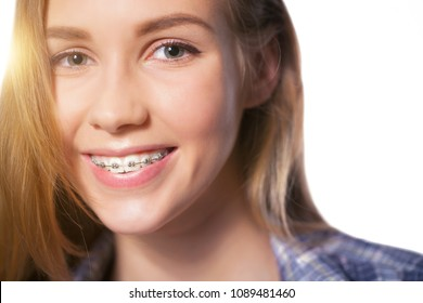Beautiful young blondie girl showing her dental braces