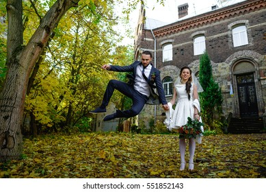 beautiful young bride and groom having fun in the park