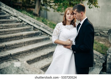 beautiful and young bride and groom walking outdoors