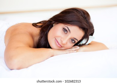 beautiful young bride lying on bed