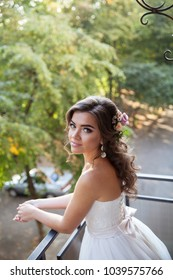 Beautiful young bride on the wedding day. Holiday dress