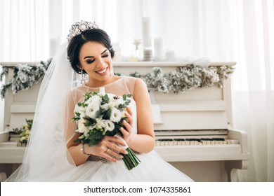 Beautiful young bride with wedding bouquet