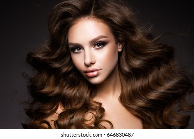 Beautiful young brunette with bright make up