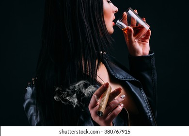Beautiful young brunette girl with cigarette and alcohol