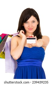 beautiful young brunette happy woman holding shopping bags and credit card isolated on white