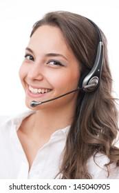Beautiful young brunette woman in offfice wearing headset.