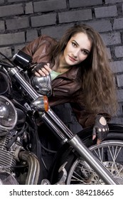 beautiful young brunette woman on a motorcycle