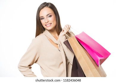 Beautiful young brunette woman with shopping bag isolated on white background.