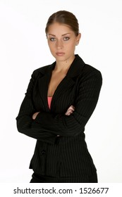 Beautiful Young Business Woman with Arms Folded Looking at Camera