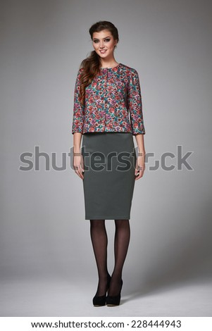 4eb56527ea5b1a Beautiful young business woman with evening make-up wearing a skirt to the  knee and