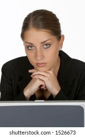 Beautiful Young Business Woman with Hands Folded at Laptop