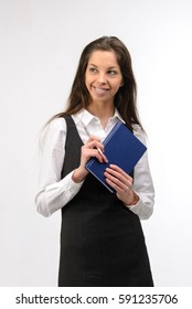 Beautiful young business woman with notebook, on white