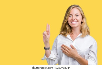 Beautiful young business woman over isolated background Swearing with hand on chest and fingers, making a loyalty promise oath