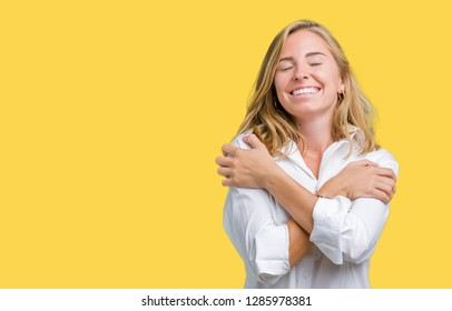 Beautiful young business woman over isolated background Hugging oneself happy and positive, smiling confident. Self love and self care