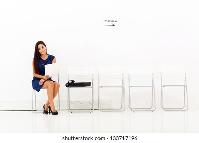 beautiful young business woman preparing for job interview