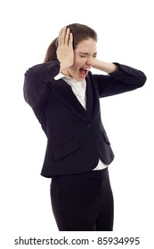 Beautiful young business woman screaming, Hands at her ears, mouth wide open, eyes closed isolated over white background