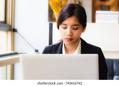 Beautiful young business woman Use a laptop to work in a coffee shop or office. Business people use laptops, email checks, or meeting today. Businesswoman using laptop and drink hot coffee in cafe