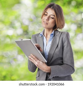 beautiful young business woman using her tablet