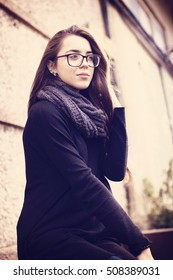 Beautiful young business woman wearing glasses