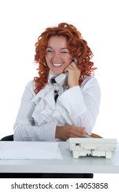 Beautiful young businesswoman calling in office