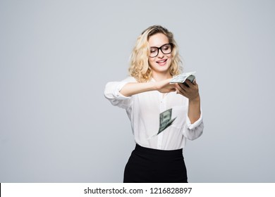 Beautiful young businesswoman Scattering money isolated on white