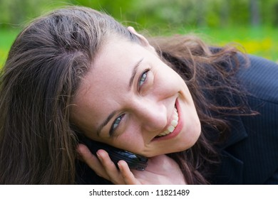 Beautiful young businesswoman speaking on cell phone