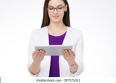 beautiful young businesswoman with tablet pc in the hands
