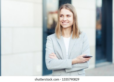 Beautiful young businesswoman using smartphone
