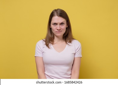 beautiful young caucasian girl is angry with her husband. Studio shot