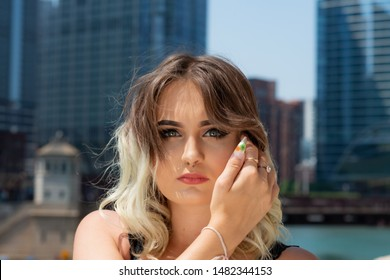 Beautiful Young Caucasian Girl with Barbell septum Nose Ring (Horseshoe Nose Ring) in Windy City at a sunny summer day.