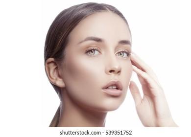 Beautiful young caucasian girl with natural makeup looking at camera. Woman portrait.