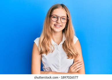 Beautiful young caucasian girl wearing casual clothes and glasses happy face smiling with crossed arms looking at the camera. positive person.